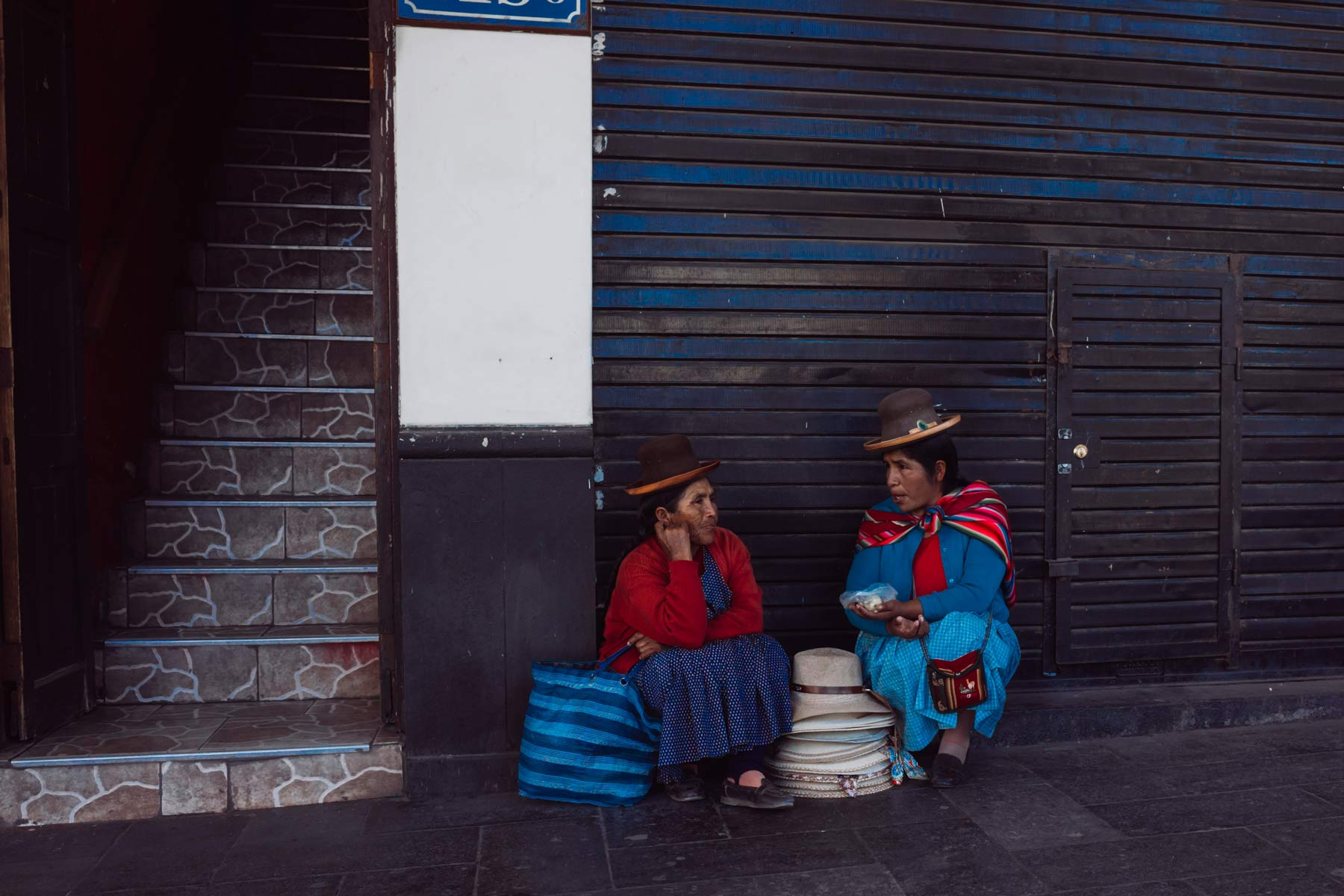 Two woman sharing food and conversation during lunchtime in Arequipa.