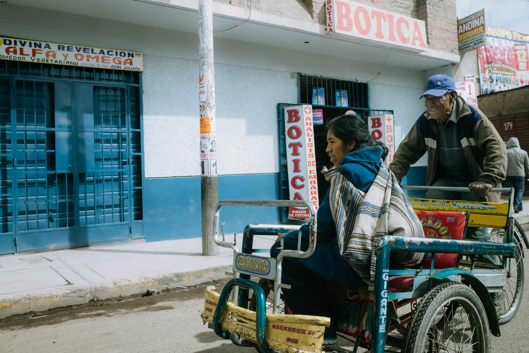 A woman rides on a bicycle taxi in Juliaca, Peru.