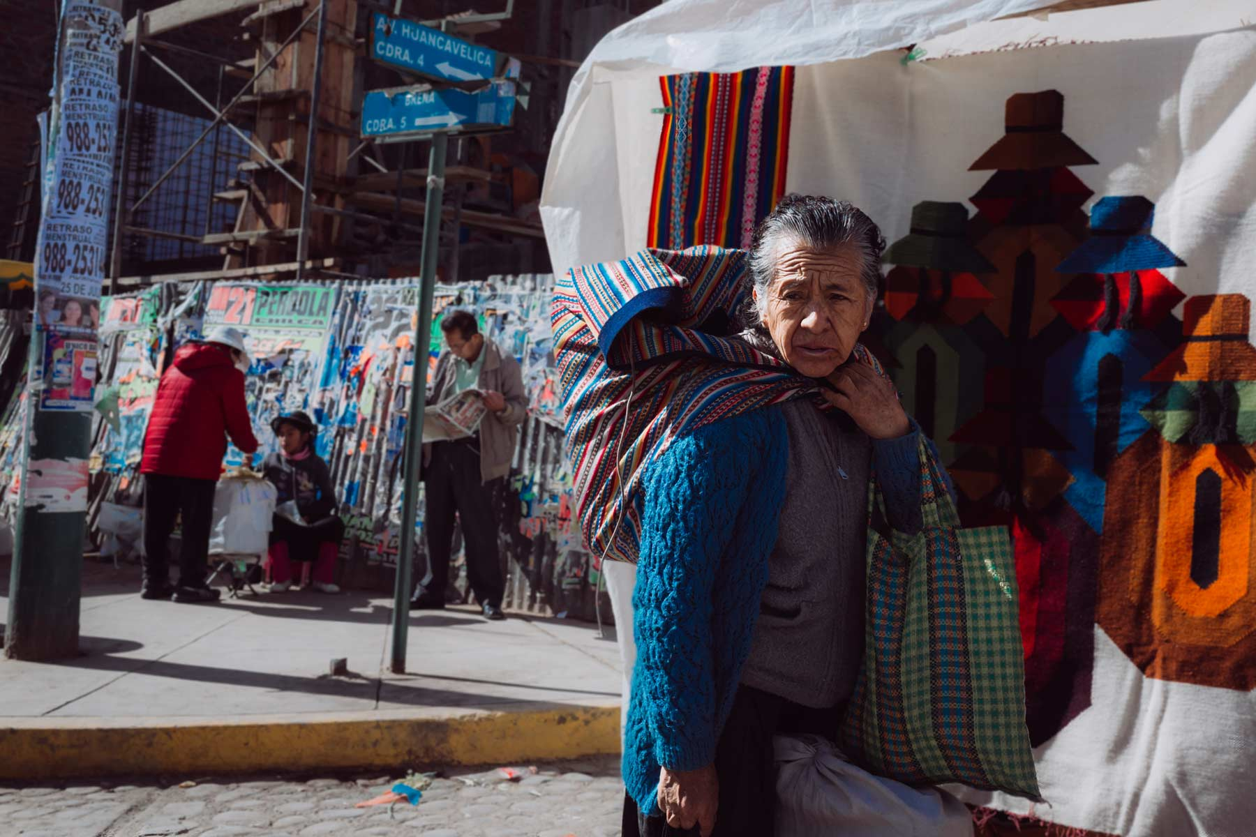 A woman carries goods from a local market in Huancayo.