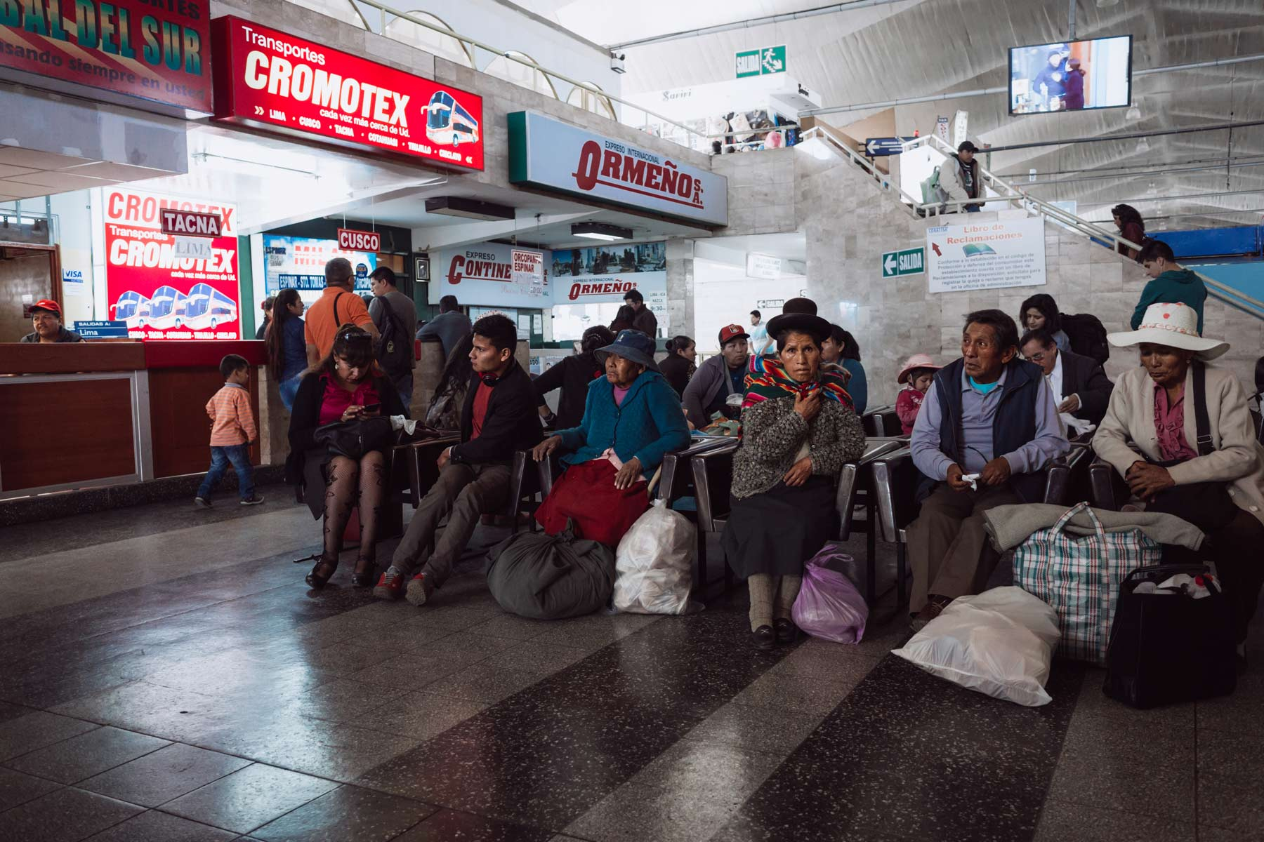 Passengers waiting for their long distance bus in Arequipa.