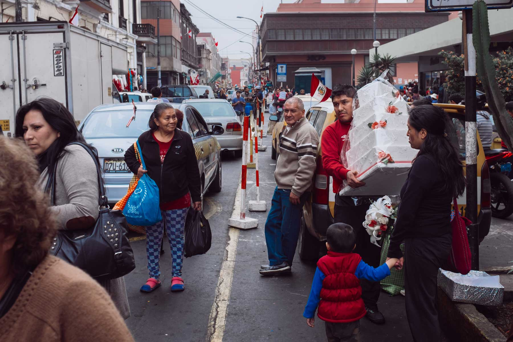 Friends and family in the busy market district of downtown Lima.