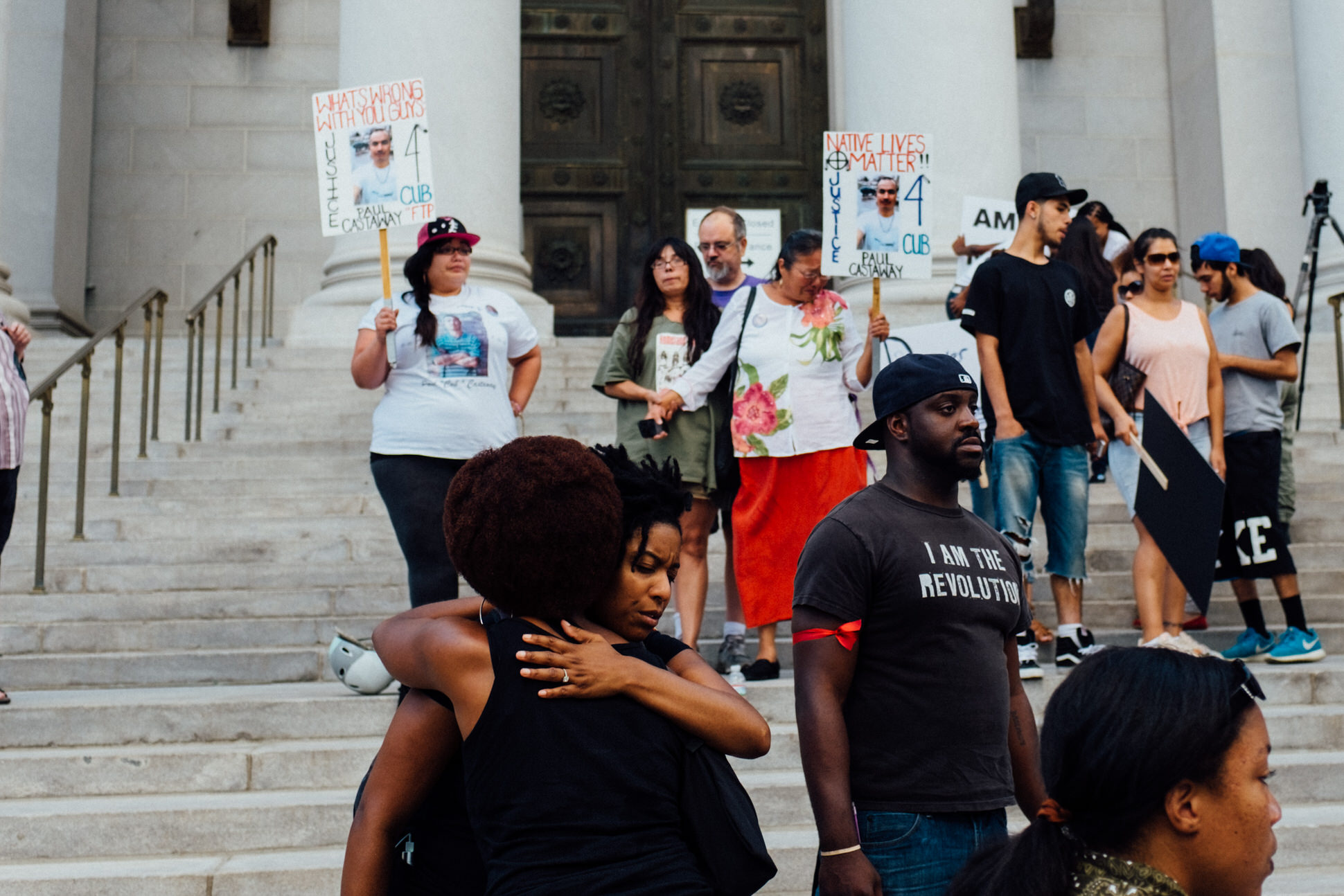 Participants of the BLM 5280 march embrace after a vigil is held on the steps of Denver's District Courthouse for victims of police violence.