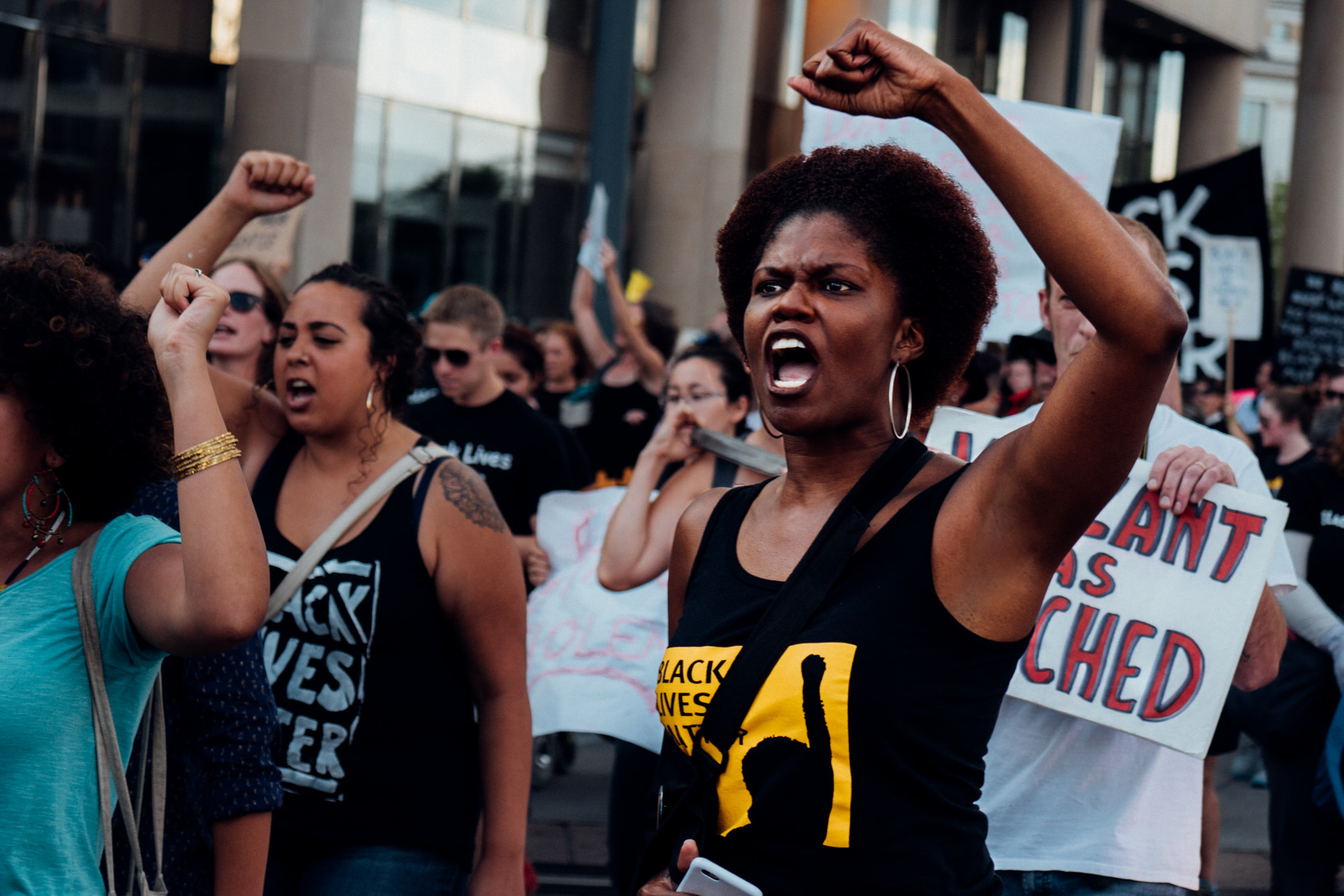 """Reverend Dawn Riley Duval, one of the leaders of BLM 5280 organization joins in chanting """"No justice no peace""""."""